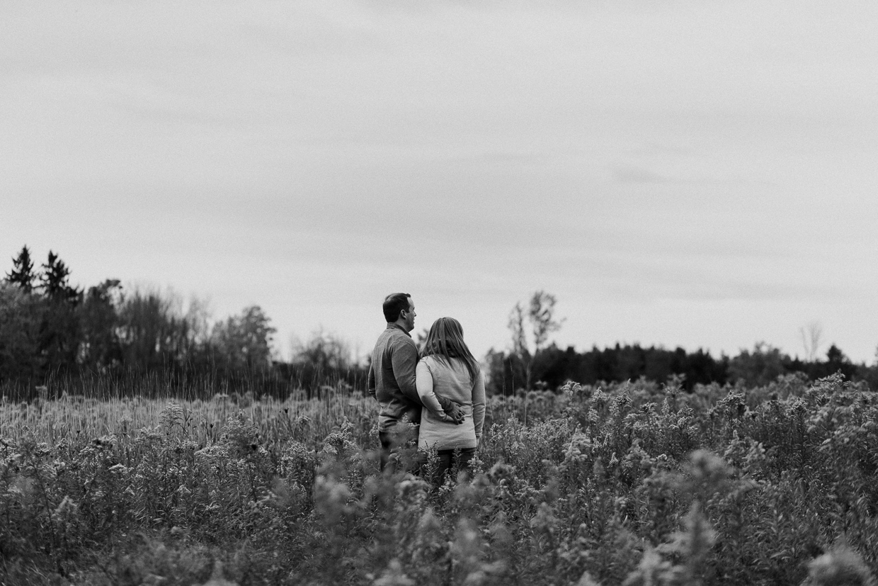 Lynde Shores Engagement - couple standing in tall grass