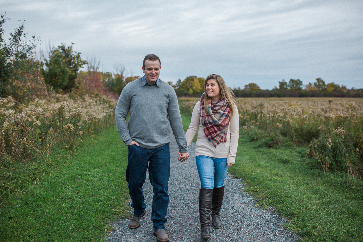 Lynde Shores Engagement - walking hand in hand through the park