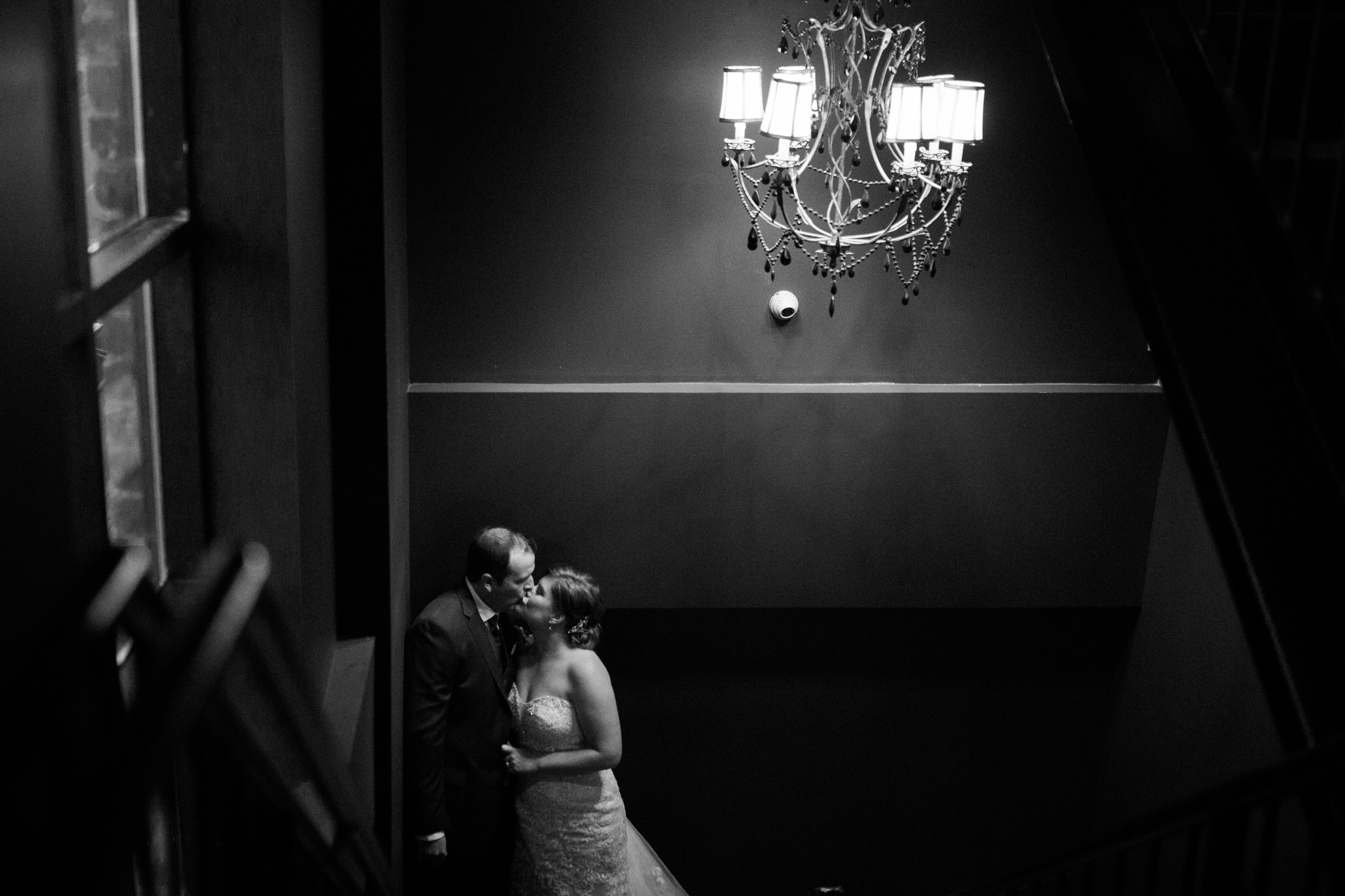 Brock Street Brewing Co. Wedding - kissing on the stairs