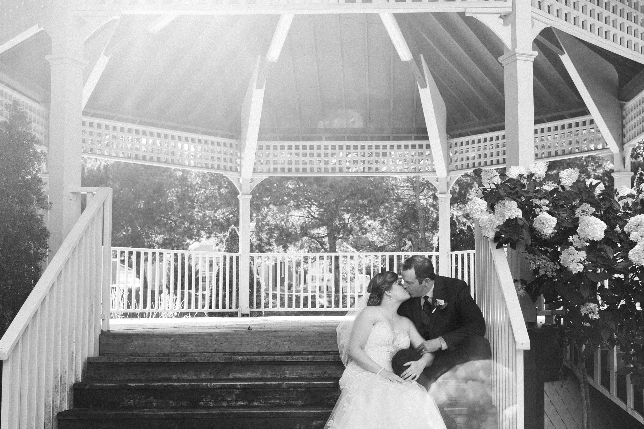 Brock Street Brewing Co. Wedding - kissing in the band stand