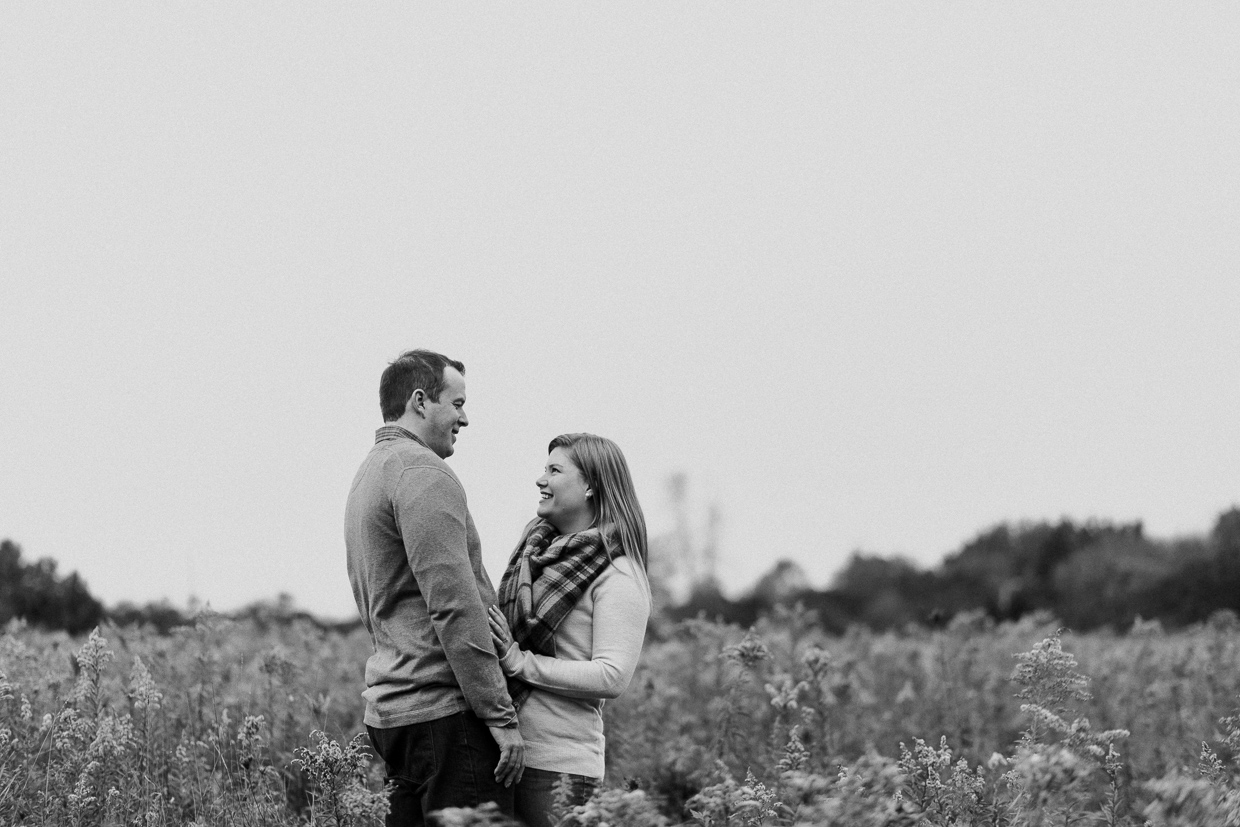 Lynde Shores Engagement - couple laughing in the field