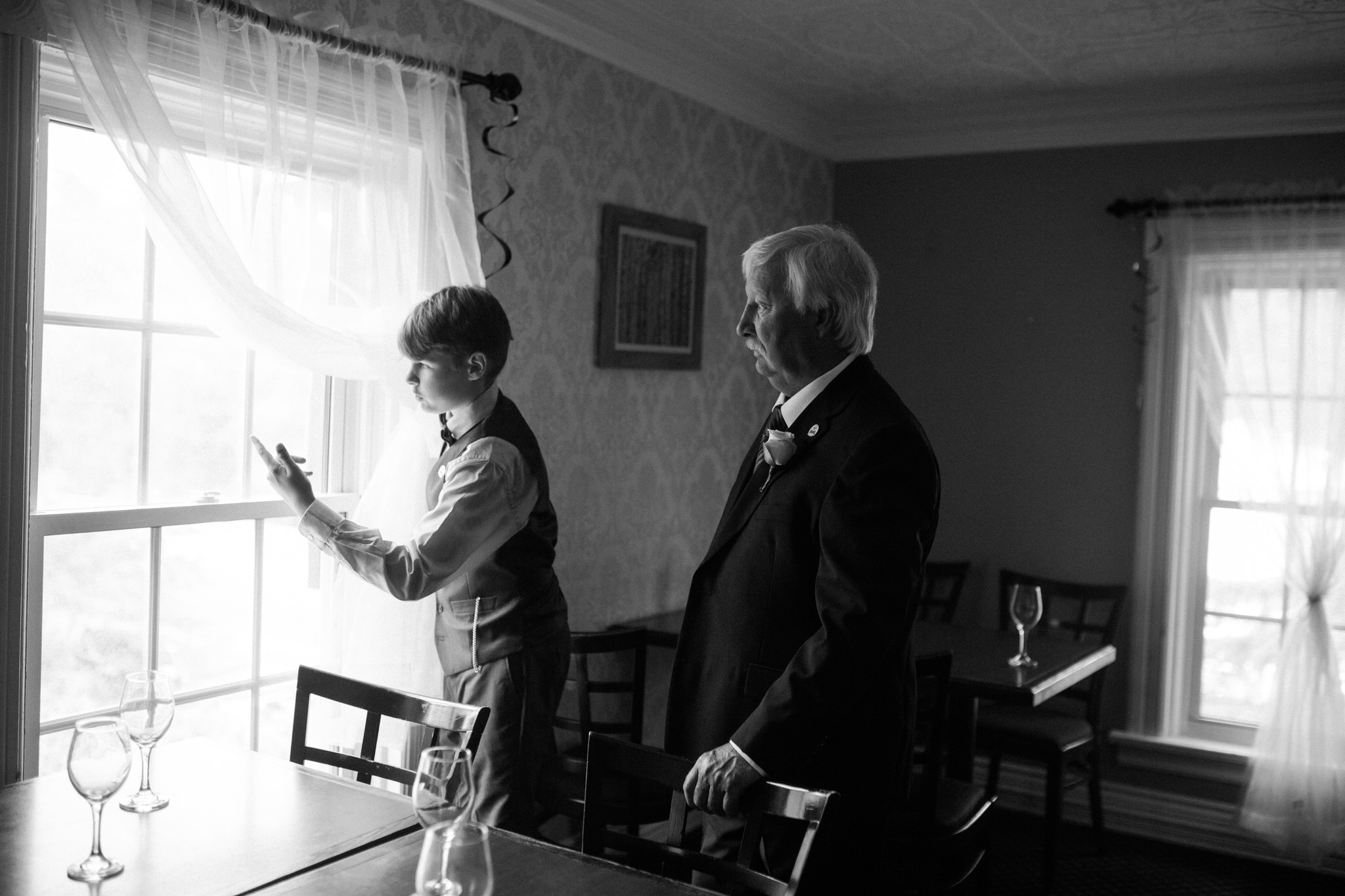 Harvest Restaurant Wedding Brooklin Ontario - Son and grandfather look out window