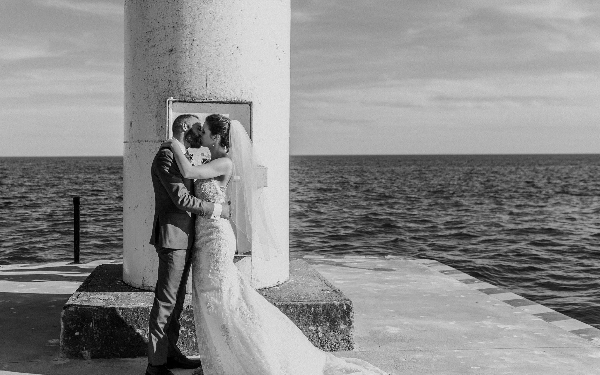 Brock Street Brewery Wedding - bride and groom kiss on the pier