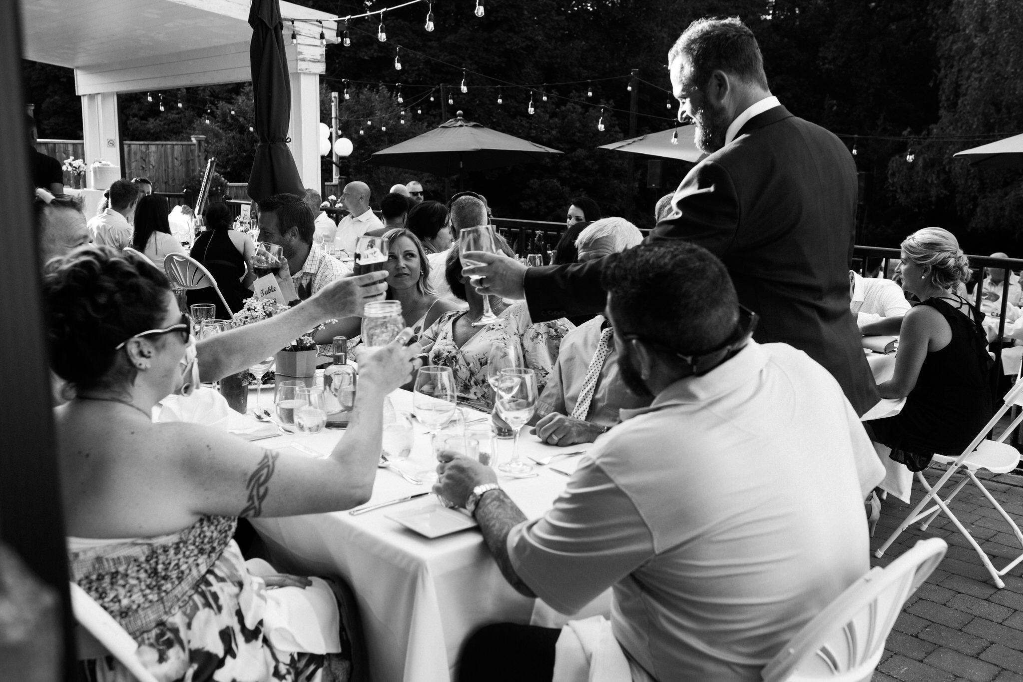 Harvest Restaurant Wedding Brooklin Ontario - Cheers with the groom