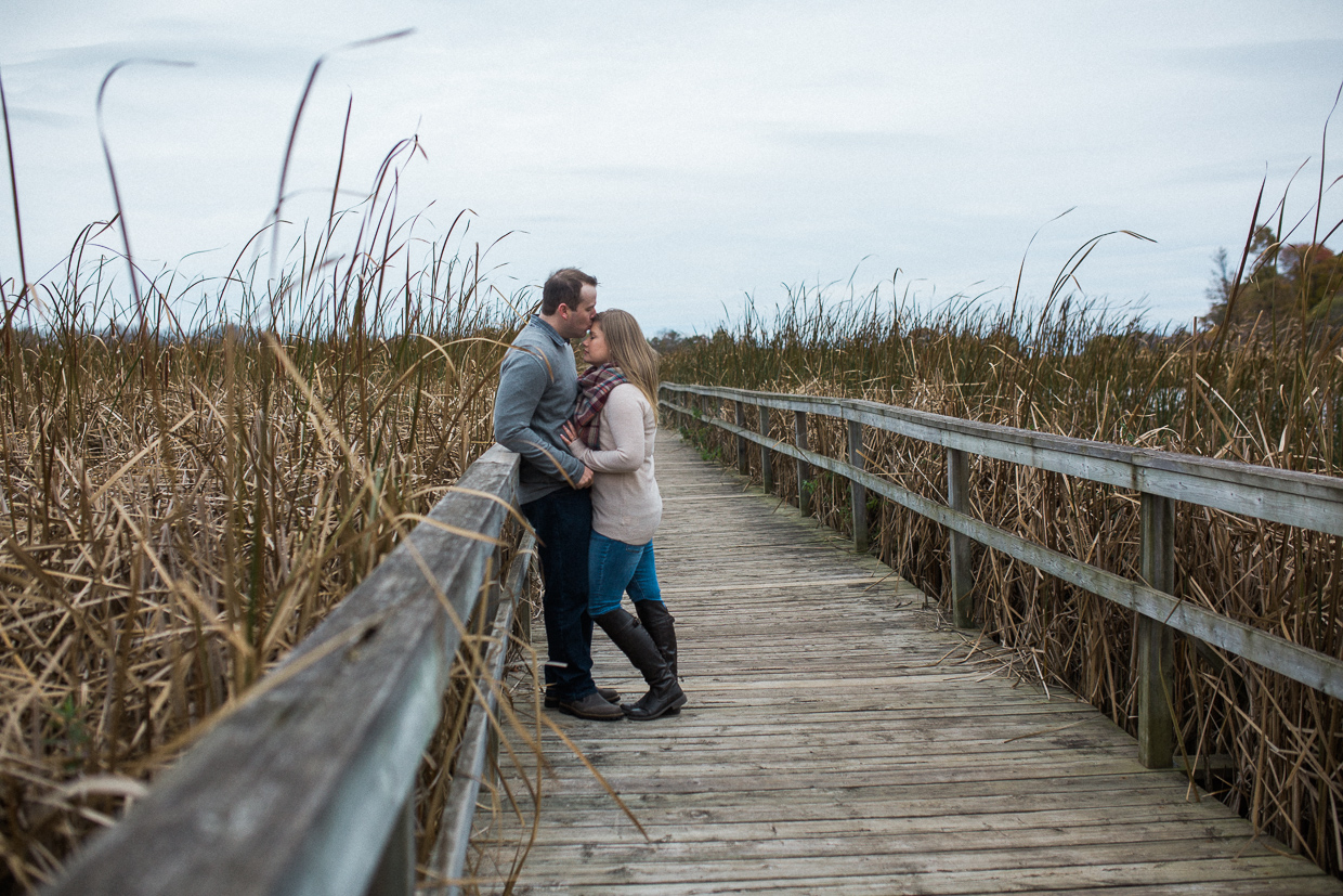 Lynde Shores Engagement - forehead kisses on the boardwalk