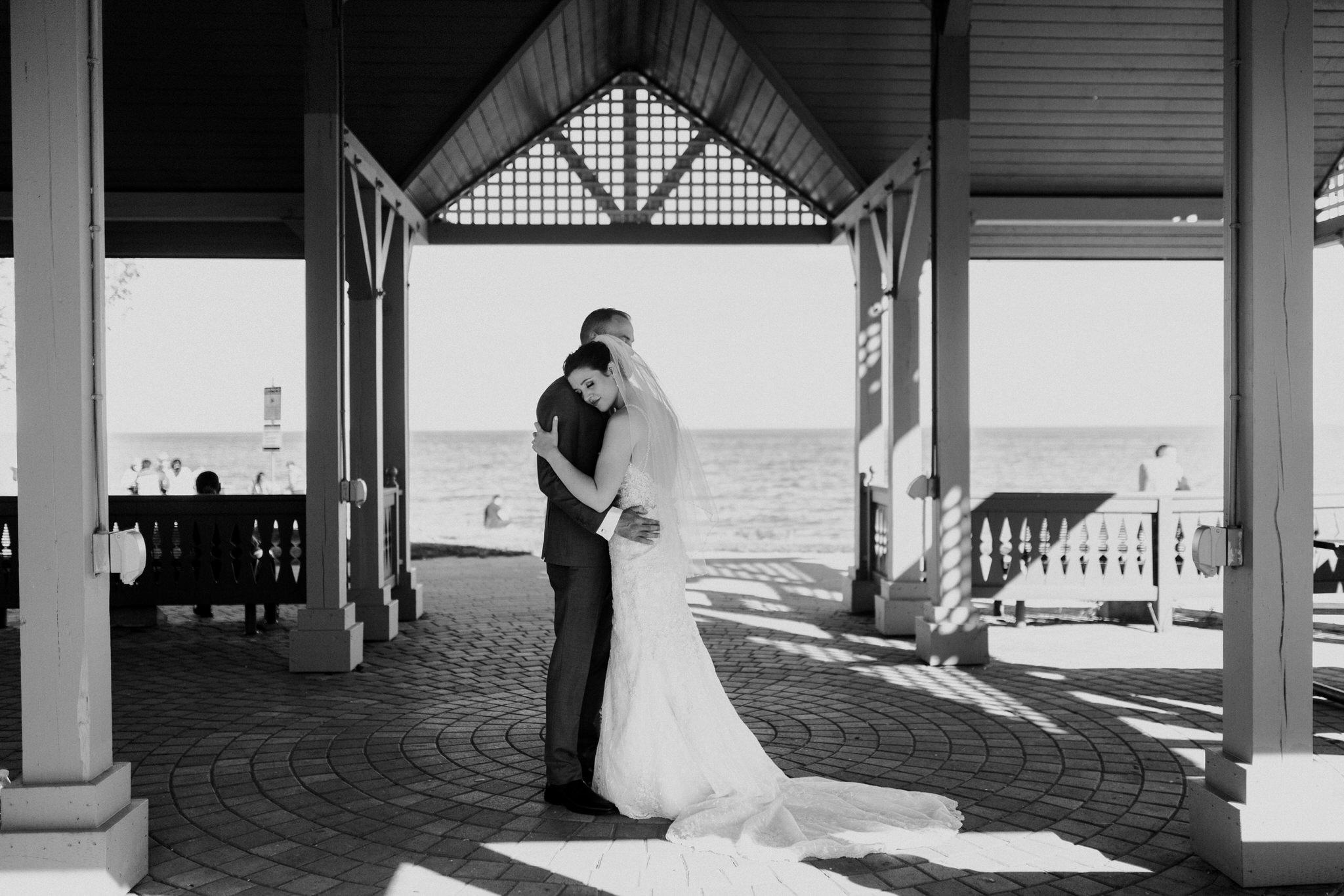 Brock Street Brewery Wedding - bride and groom hugging