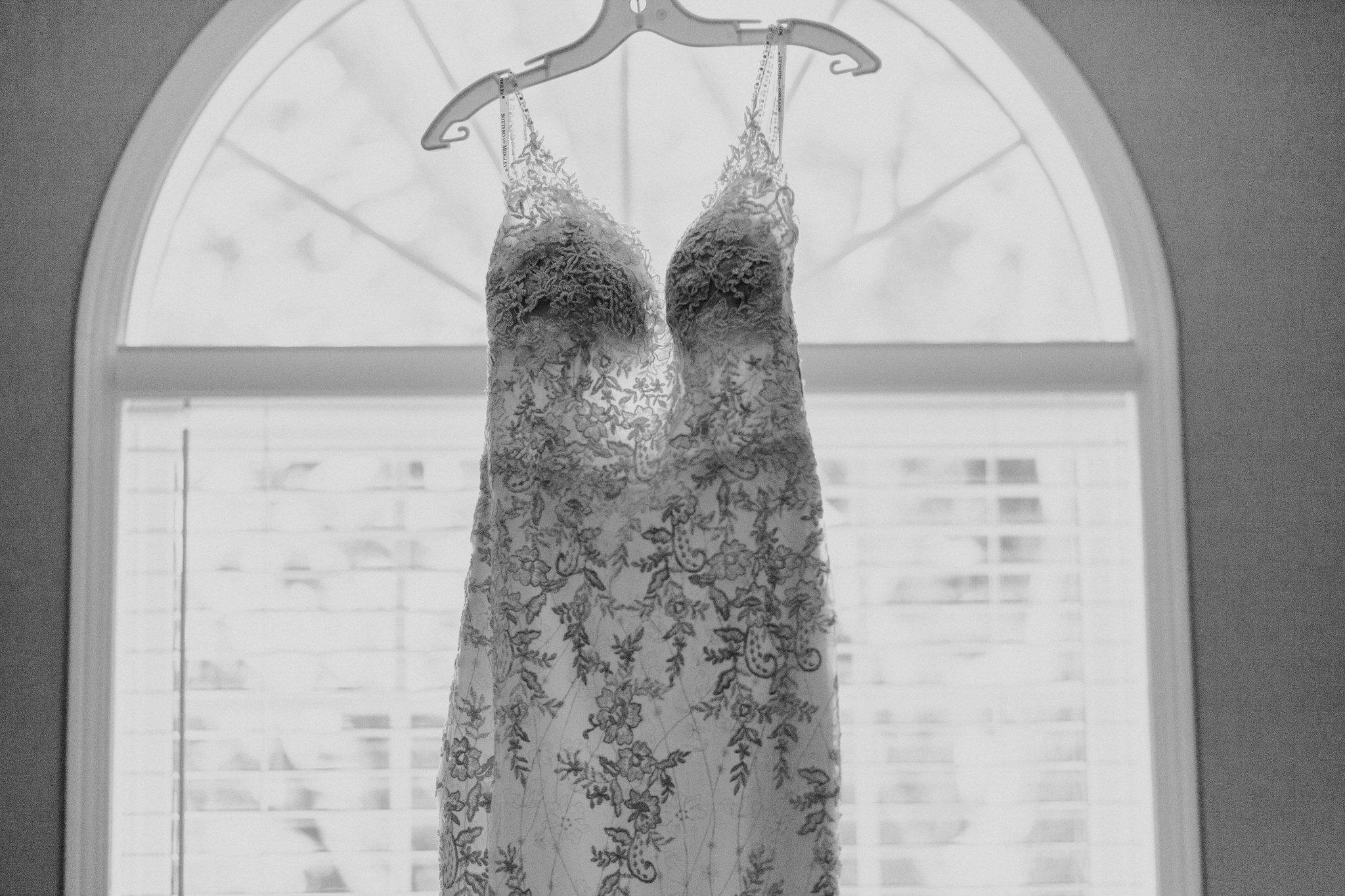 Whitby Wedding Photographer Carol Poitras - - Dress in window