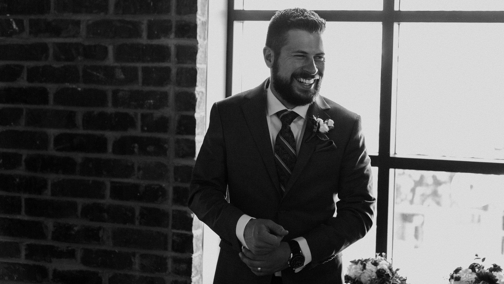 Brock Street Brewery Wedding - Groomsman laughing