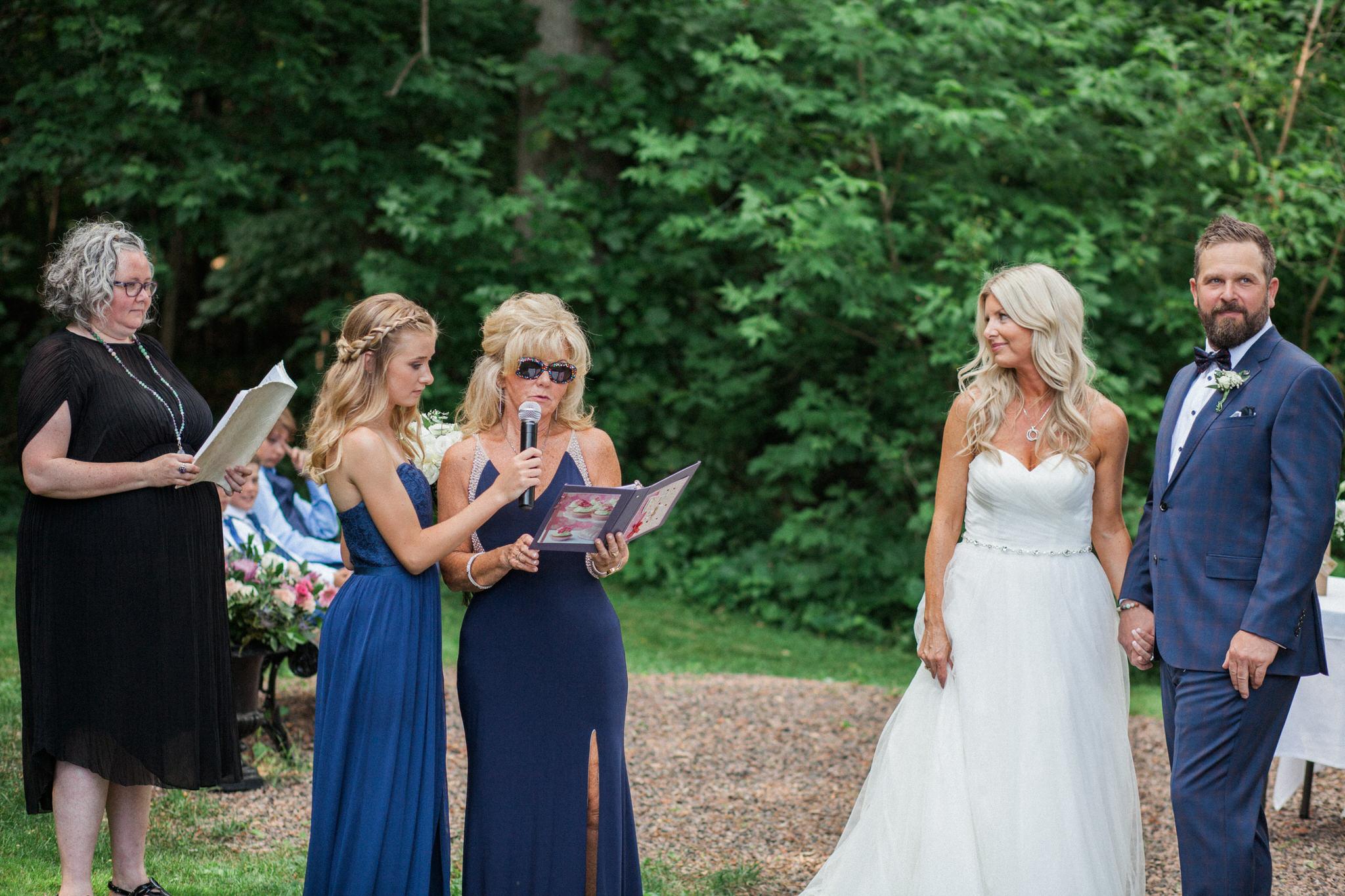 Harvest Restaurant Wedding Brooklin Ontario - speeches during the outdoor ceremony