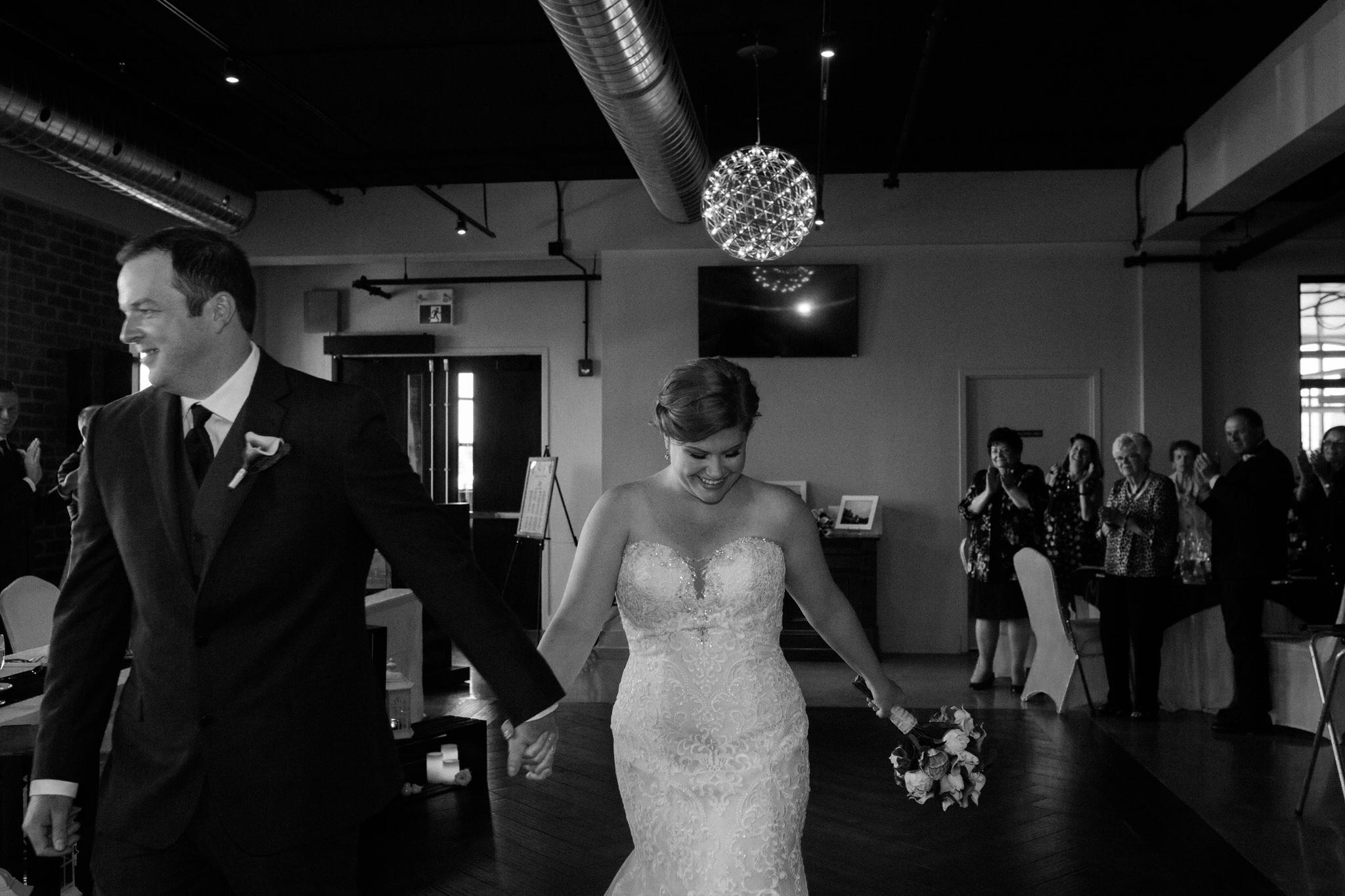 Brock Street Brewing Co. Wedding - bride and groom entrance