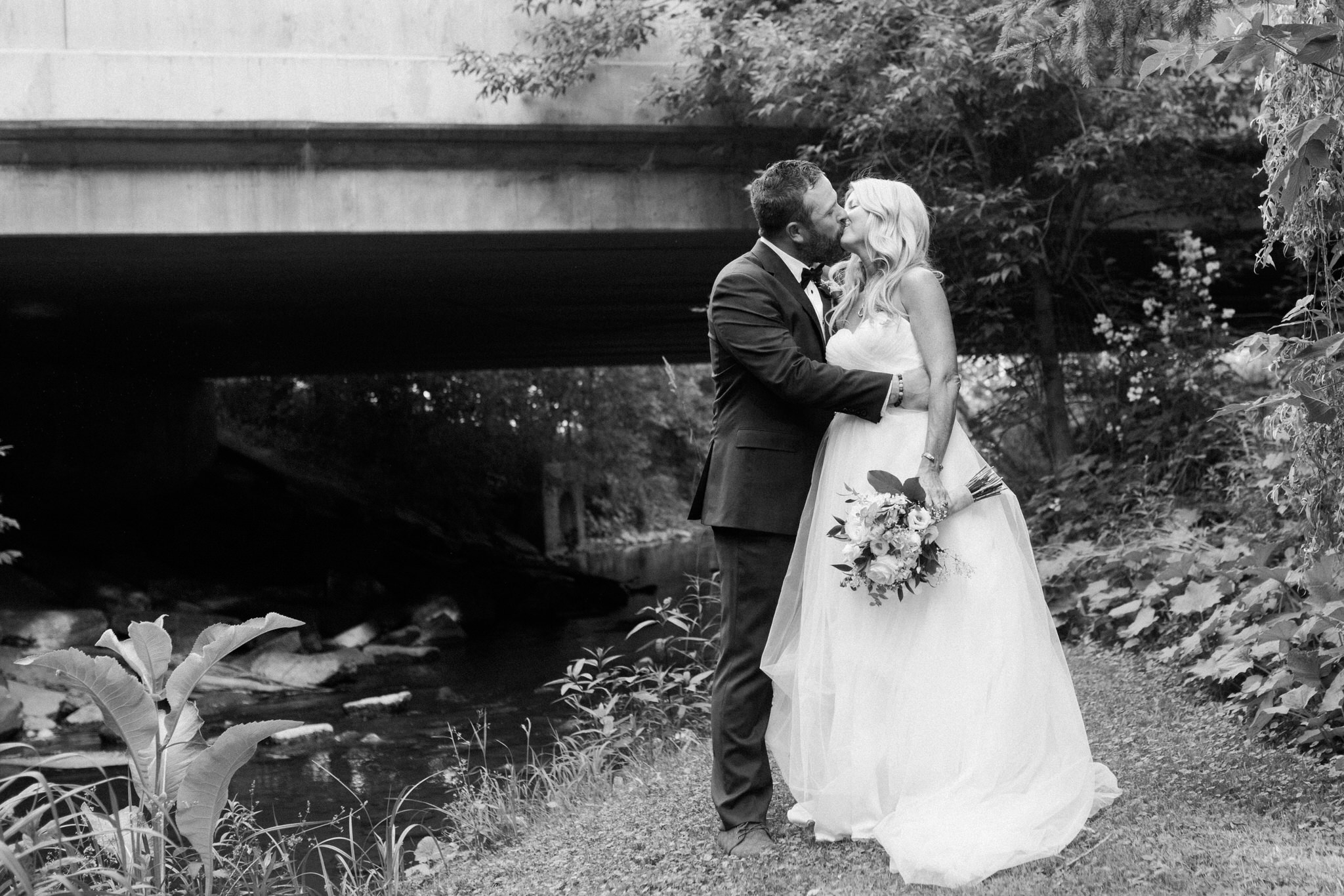 Harvest Restaurant Wedding Brooklin Ontario - Bride and groom kiss by the river