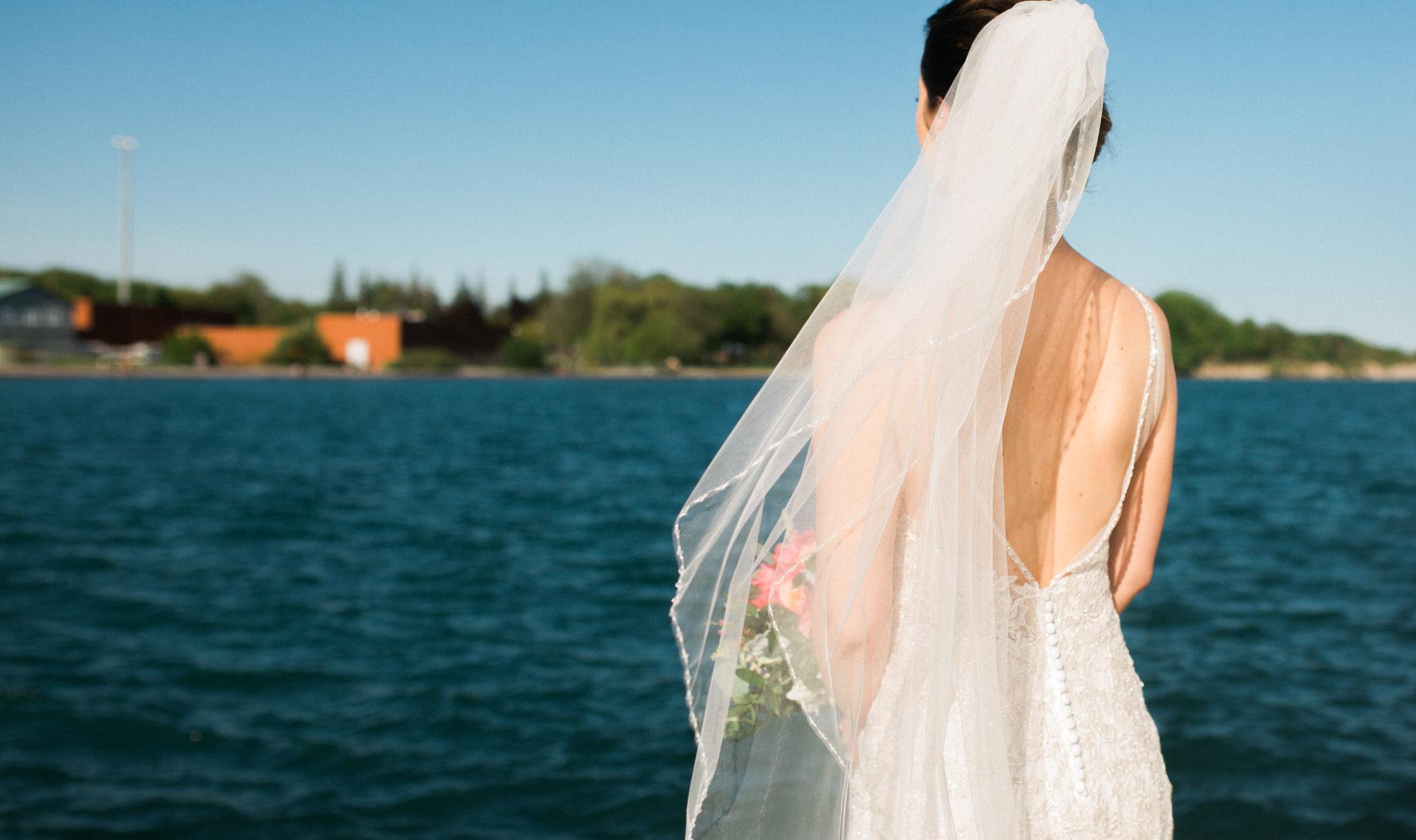 Brock Street Brewery Wedding - bride with veil at the beach