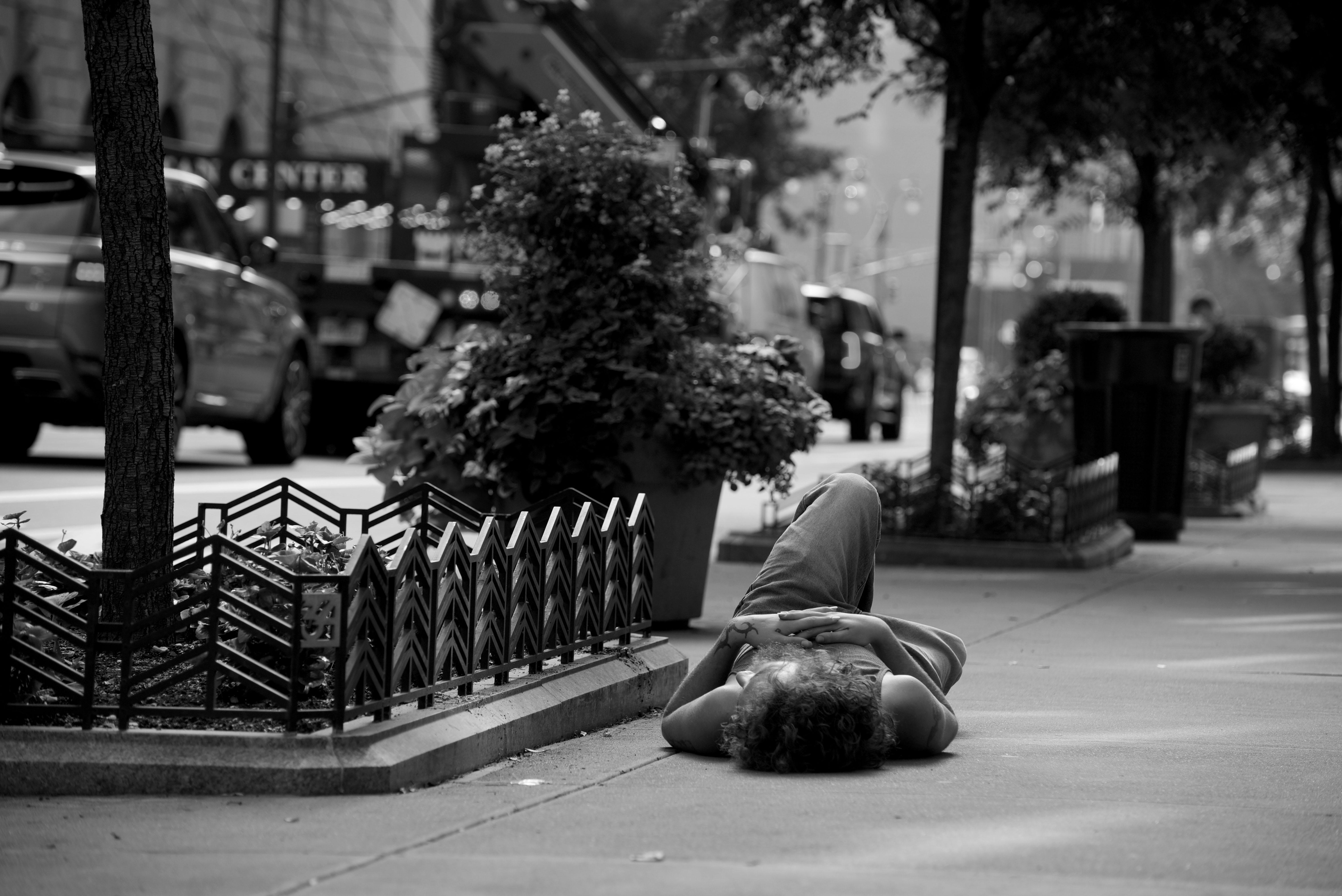 August guy lying on floor 34th street