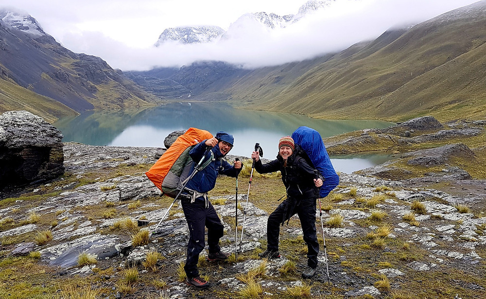 hikers in front of lake, Cordillera Real, Bolivia, Laguna Khotia