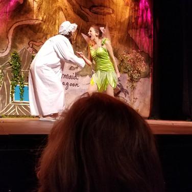 "As Tinker Bell in ""Peter Pan"""