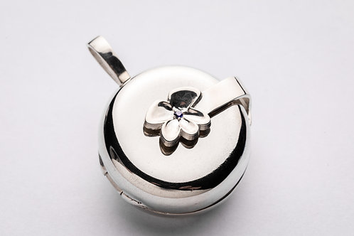 Small violet petals locket with a 1.75 mm blue sapphire