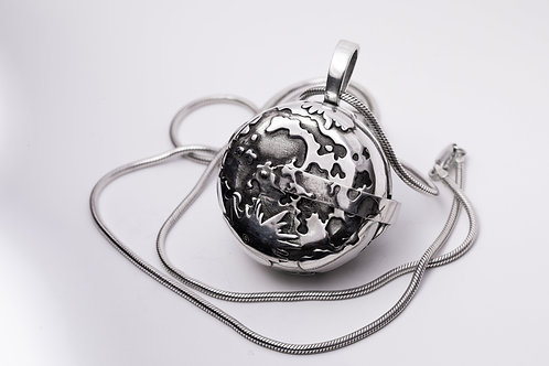 Moon landing silver locket with patina & with astronauts and the lunar module