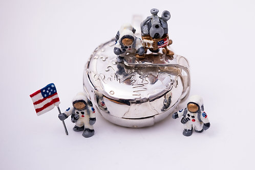 Moon landing silver locket with astronauts and the lunar module