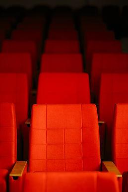 bigstock-Empty-Row-Of-Seats-In-Cinema-T-277309822.jpg