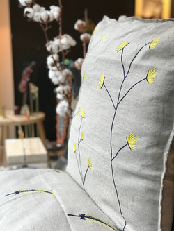Hand-embroidered cushion cover