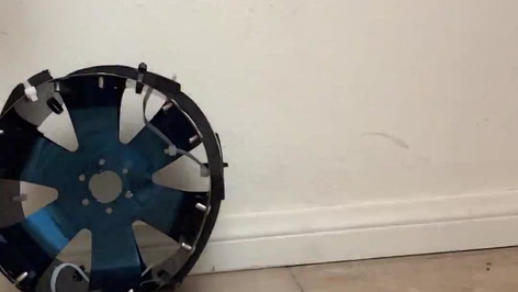 I am stomping on the wheel as hard as I can in this video. It is absorbing shock, deforming, springing back with no damage.