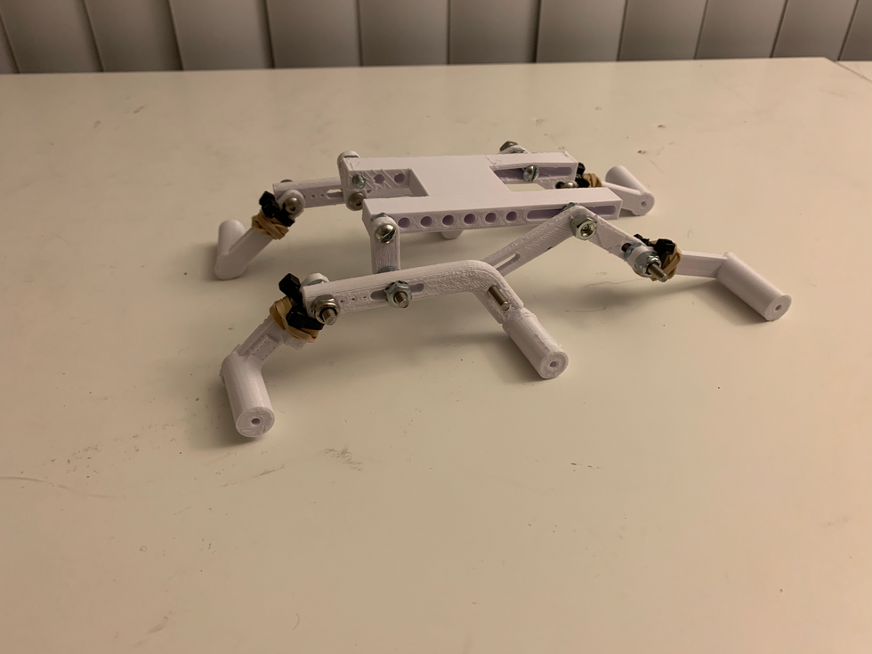 the scale 3d printed model used rubber bands to simulate the suspension springs. It also had slots to adjust linkage lengths.