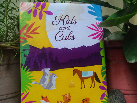 Kids and Cubs by Olga Perovskaya is a heartwarming book of animals stories