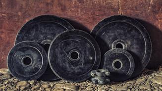 black-bumper-plates-dirty-161557.jpg