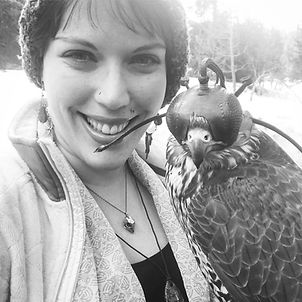 Black and white photo of Hannah Crazyhawk and Falcon