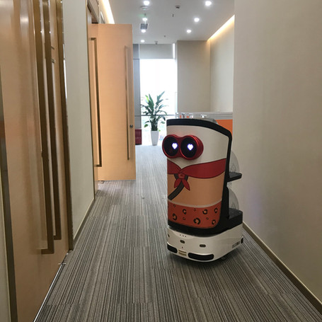 Our contactless delivery robot working in a building of Beijing