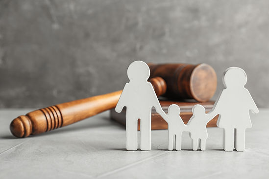 Family figure and gavel on table. Family