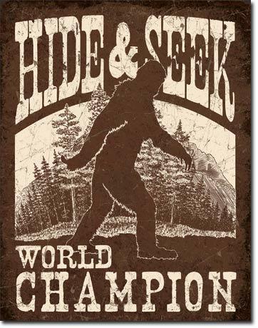 Hide and Seek World Champion Bigfoot Tin Sign