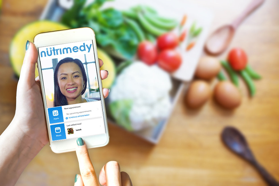Nutrimedy App on the phone with user clicking the meal log