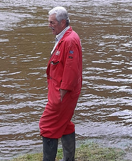 Graham Miller surveying the swollen banks of the river Deveron at Cobblehouse Country Cabins Aberdeenshire