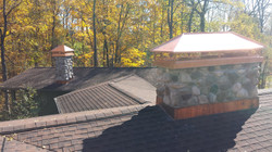 Stone chimney with copper