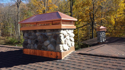 Natural stone chimney & copper caps