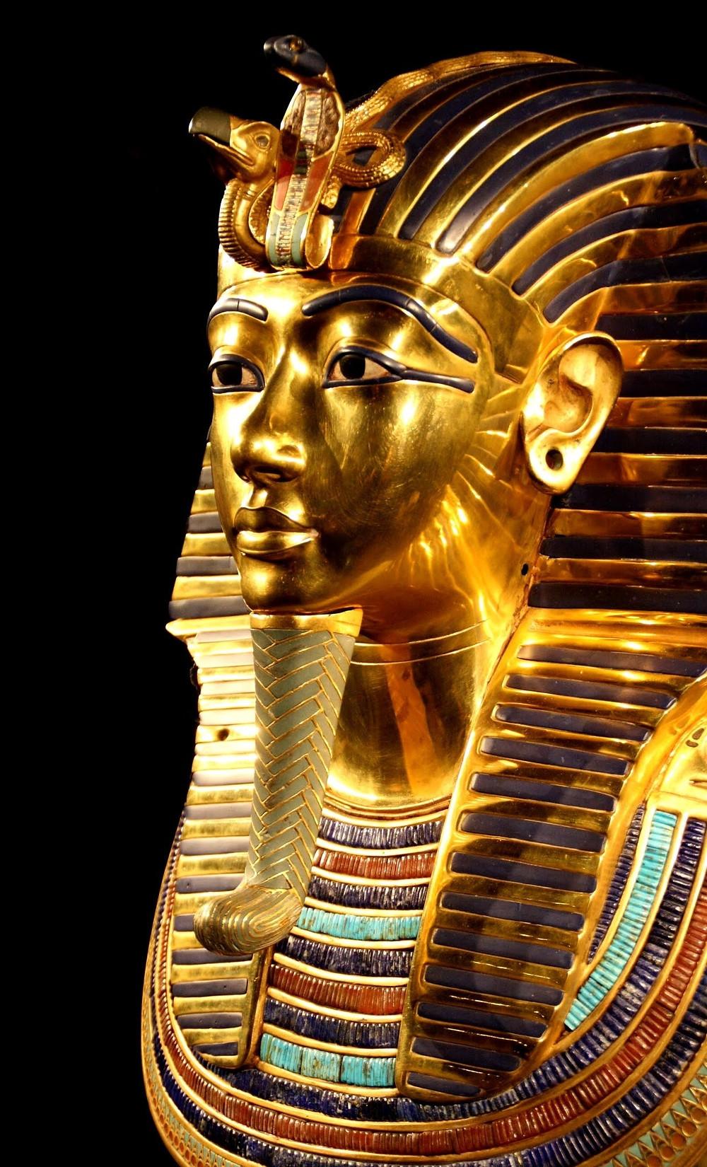 Gold Egyptian sculpture.