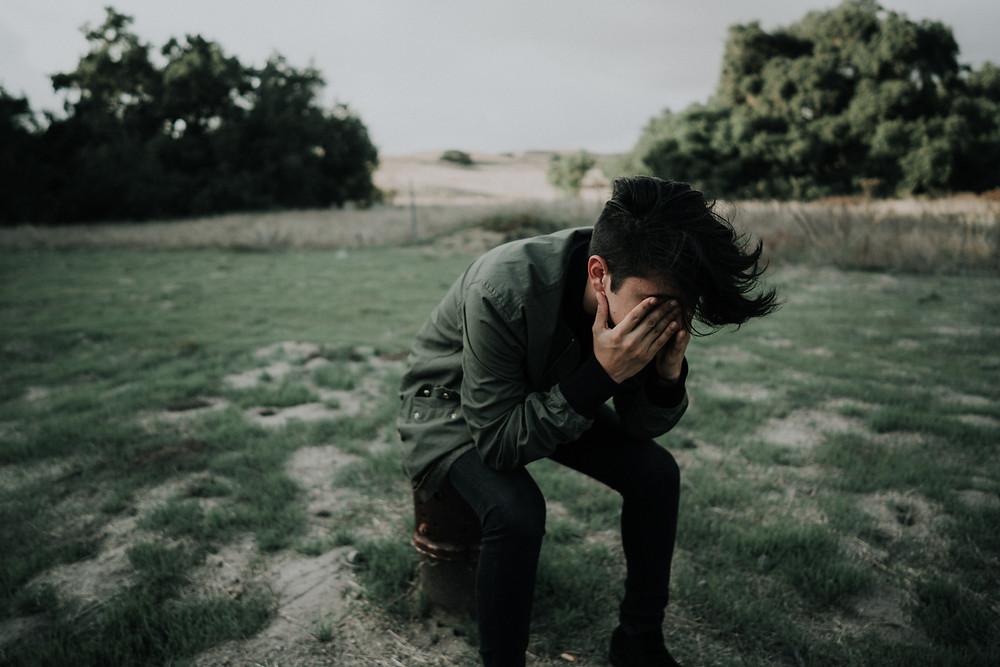 Sad guy in a field