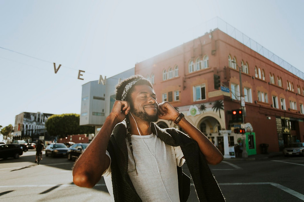 Black Guy with headphones on smiling