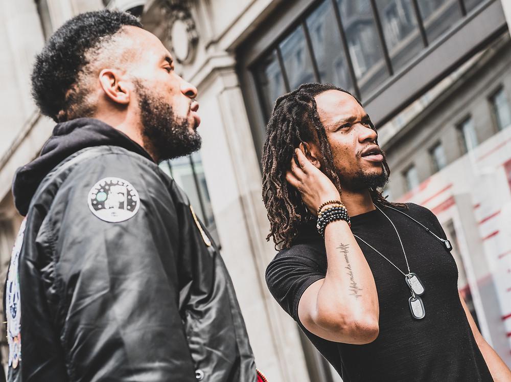 Two Black Men Talking