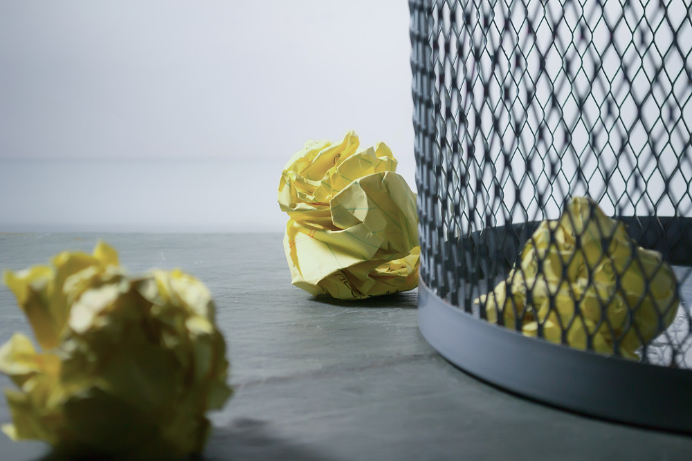 Wastebasket with crumbled sticky notes