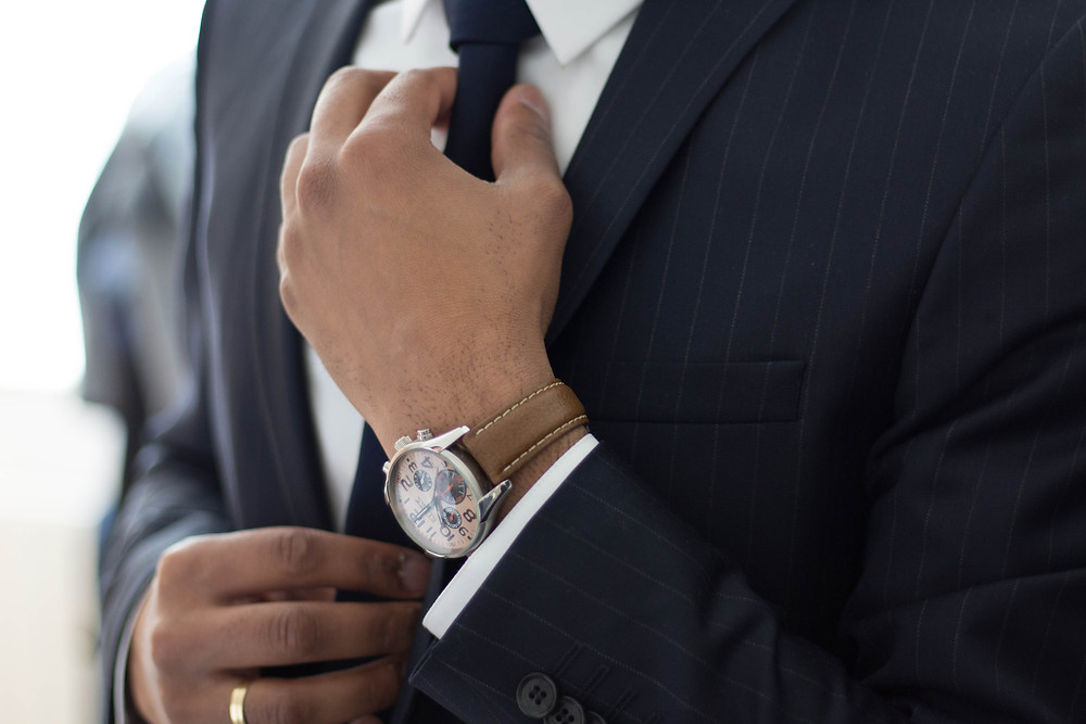 Man in a suit and tie with a watch on
