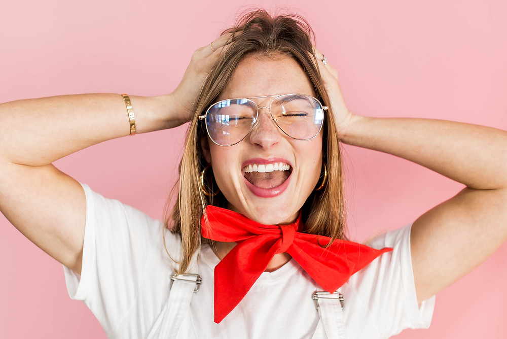 Woman with Smiling with Glasses and Red Bows