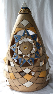 Her cloak of protection, carved with a nine petalled mandala, decorated with coloured slips and oxides.