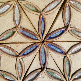 Centre detail, shows coloured glass used to define the pattern. The composition of many to form oneness.