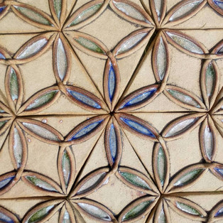 Seed of Life expands into a flower of life pattern.