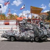 Atomic Dog Art Car in front of Orange Sh