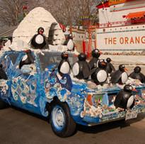 Penguin art car in front of Orange Show.