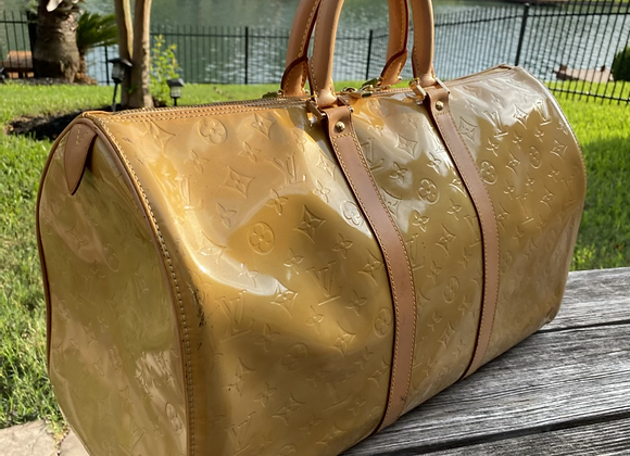 $650 preowned vernis keepall 50