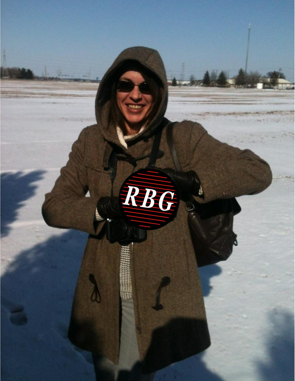 Eva holding the RBG Janitorial logo